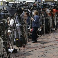 Television cameras sitting on tripods are lined up outside the federal courthouse prior to the arraignment of Dzhokhar Tsarnaev, Wednesday, July 10, 2013, in Boston. (Steven Senne/AP)