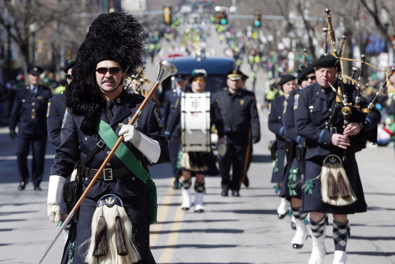 The Boston Police Gaelic Column marches in the annual South Boston St. Patrick's Day parade in 2014. This year, the parade will include, for the first time, two gay groups. (Michael Dwyer/AP)