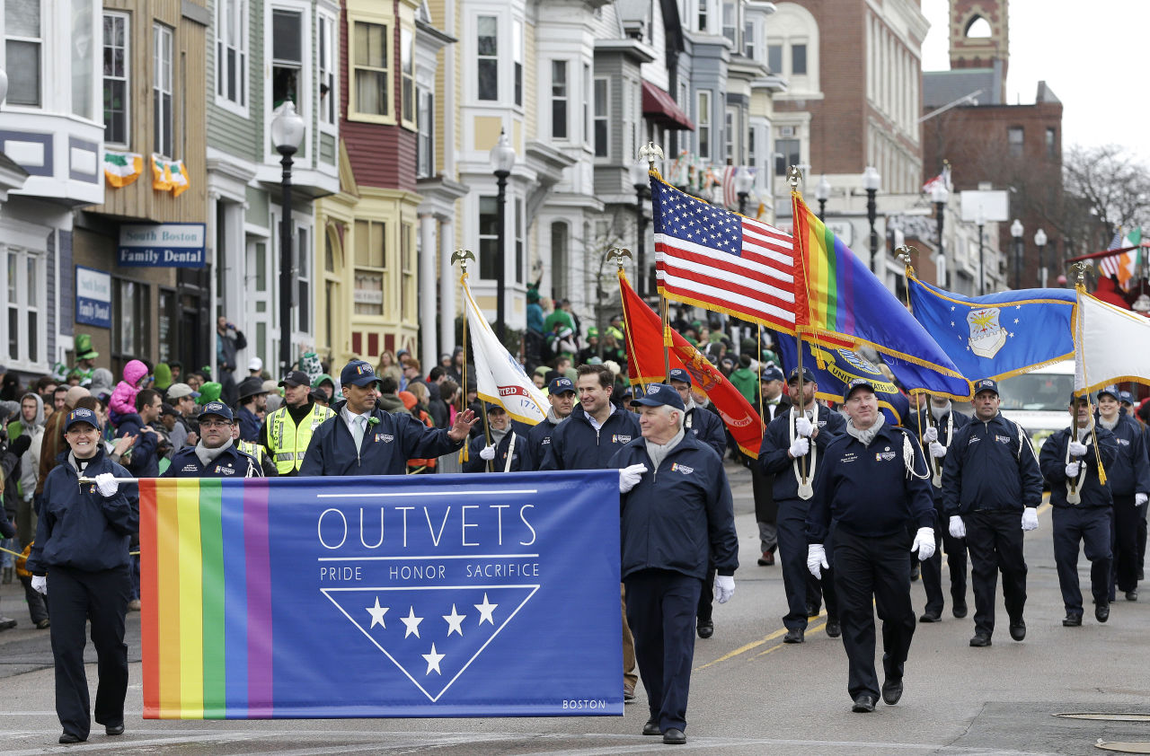 Members of OutVets, a group of gay military veterans, hold a banner and flags as they march in the St. Patrick's Day parade, Sunday in Boston's South Boston neighborhood. (Steven Senne/AP)