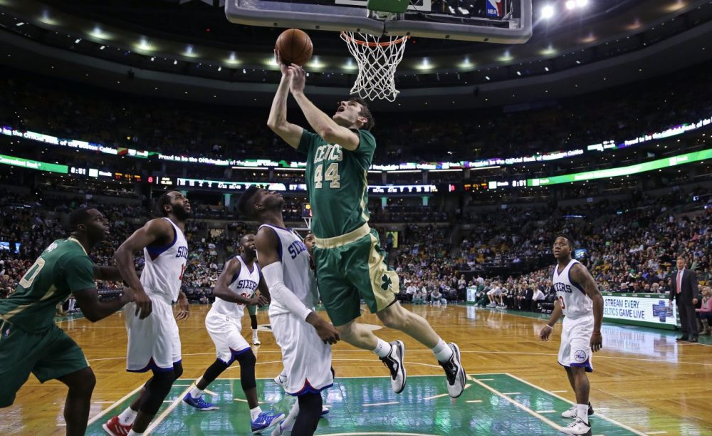 Celtics center Tyler Zeller (44) drives to the basket against the Philadelphia 76ers during the second half.  (AP Photo/Charles Krupa)
