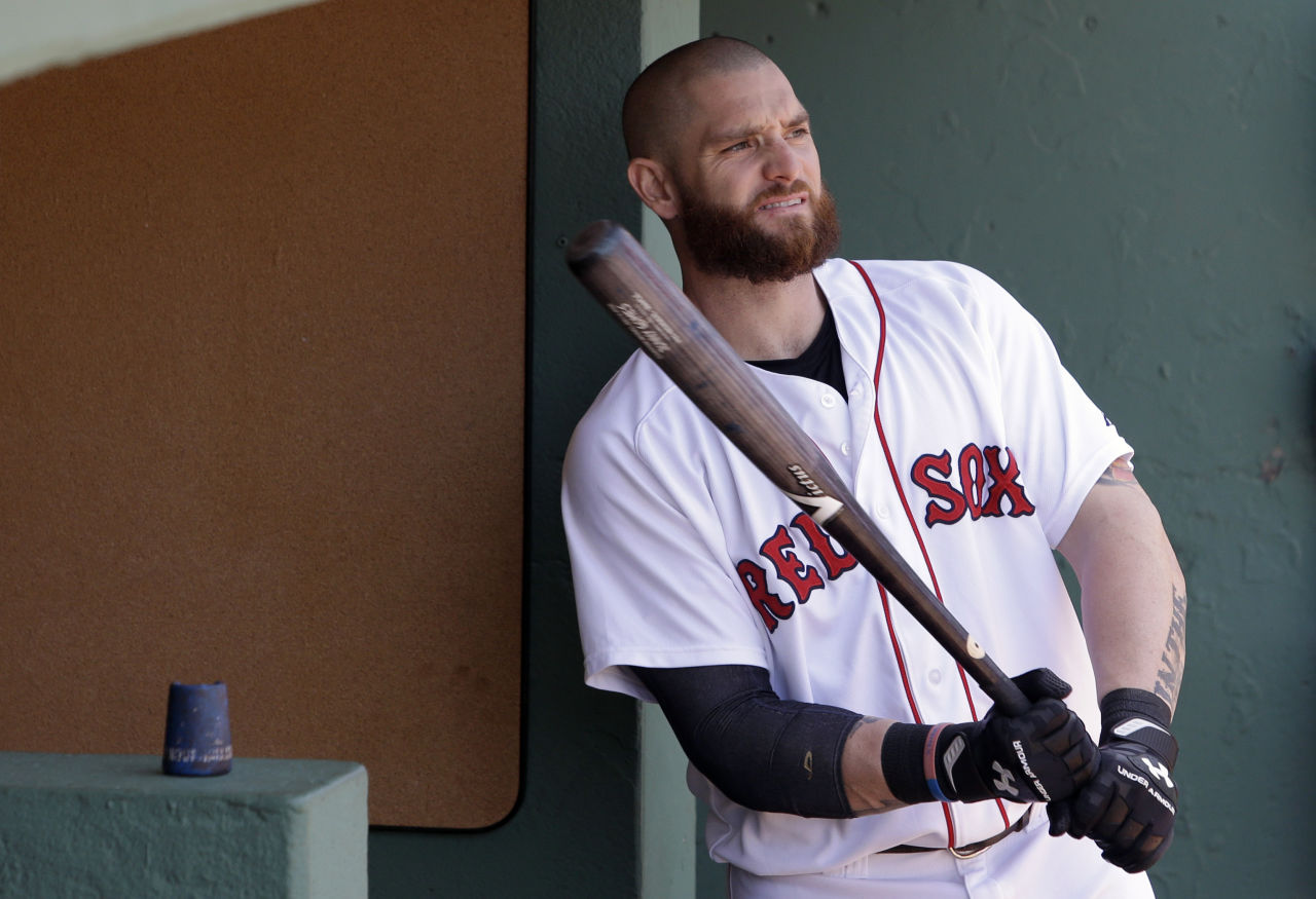 Former Red Sox left fielder Jonny Gomes holds a bat before a game in June 2014 in Boston. (Steven Senne/AP)