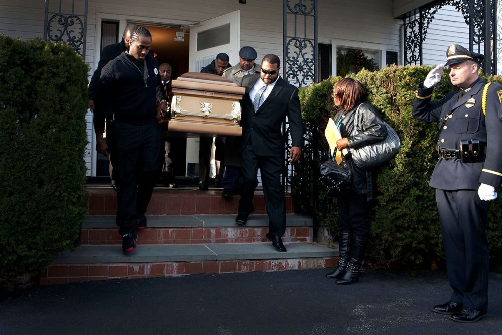 The casket of Gail Miles is carried out of her funeral service at Davis Funeral Home in Boston's Roxbury neighborhood on Dec. 12, 2011. Watertown police sent an honor guard to the Mass. (Courtesy of Kayana Szymczak)