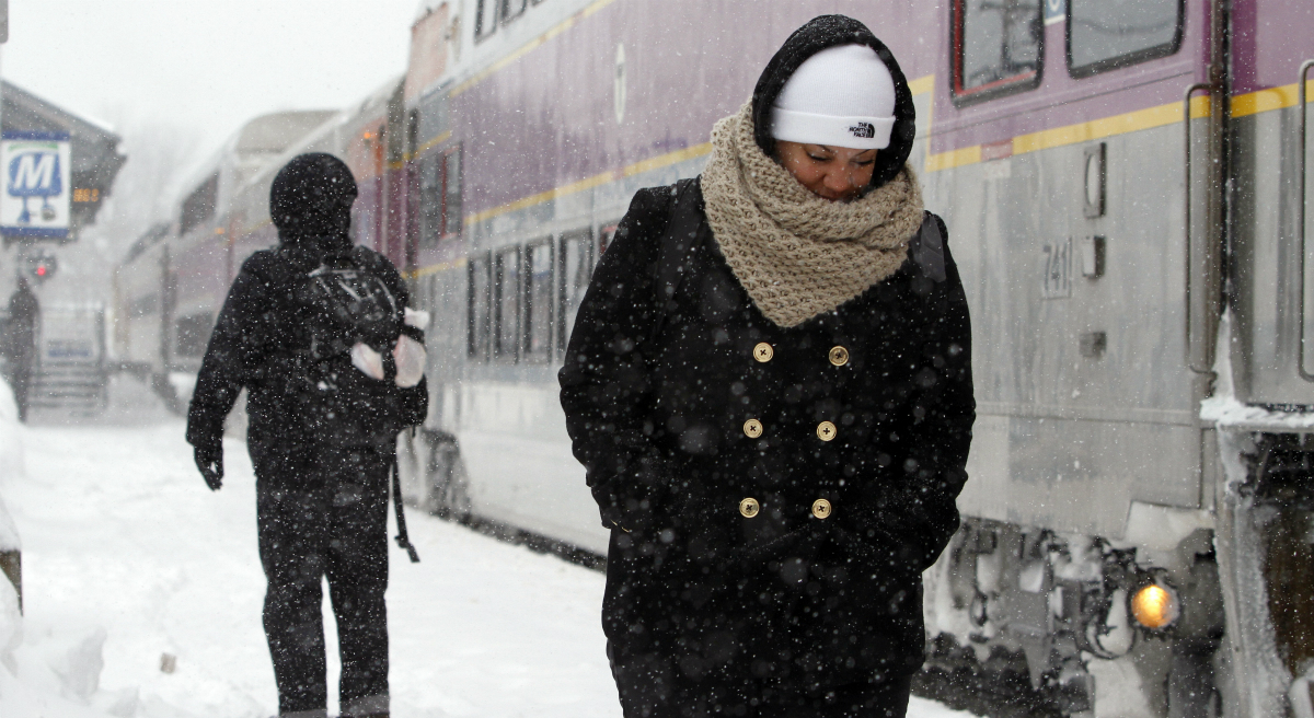 After the winter we've had, there's no time like the present to fix the state's transportation woes. In this photo, passengers wait at the commuter rail train station Monday, Feb. 9, 2015, in Framingham, Mass. (Bill Sikes/AP)
