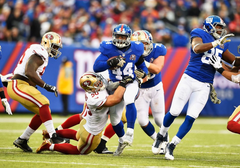 Giants running back Andre Williams (44) says he was surprised to learn 49ers linebacker Chris Borland (50) is retiring after just one NFL season. (Al Bello/Getty Images)