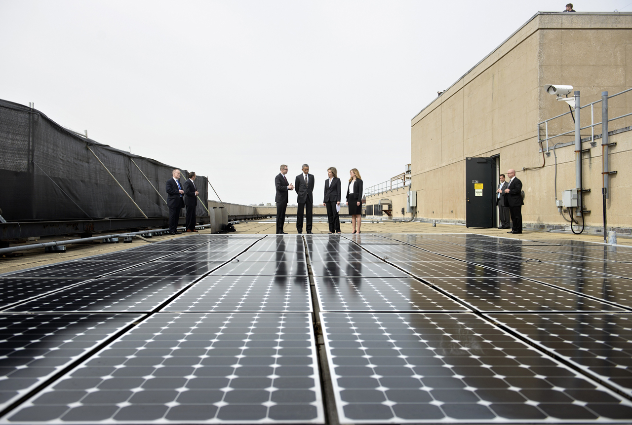 US President Barack Obama (2L), Department of Energy Deputy Secretary Liz Sherwood-Randall (2R) and Federal Chief Sustainability Officer Kate Brandt (R) listen while Eric Haukdal, an energy manager at the Department of Energy headquarters, speaks about the solar panels on the roof at the Department of Energy, March 19, 2015 in Washington, DC. (Brendan Smialowski/AFP/Getty Images)