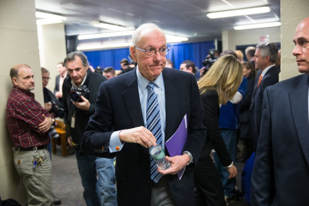 "Syracuse coach Jim Boeheim exits following his press conference Thursday morning. Boeheim called the penalties imposed by the NCAA on him and Syracuse ""unduly harsh."" (Brett Carlsen/Getty Images)"