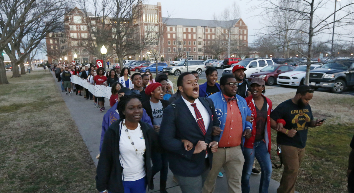 University of Oklahoma students march to the now closed University of Oklahoma's Sigma Alpha Epsilon fraternity house during a rally in Norman, Okla., Tuesday, March 10, 2015. The university's president expelled two students Tuesday after he said they were identified as leaders of a racist chant captured on video during a fraternity event. (Sue Ogrocki/AP)