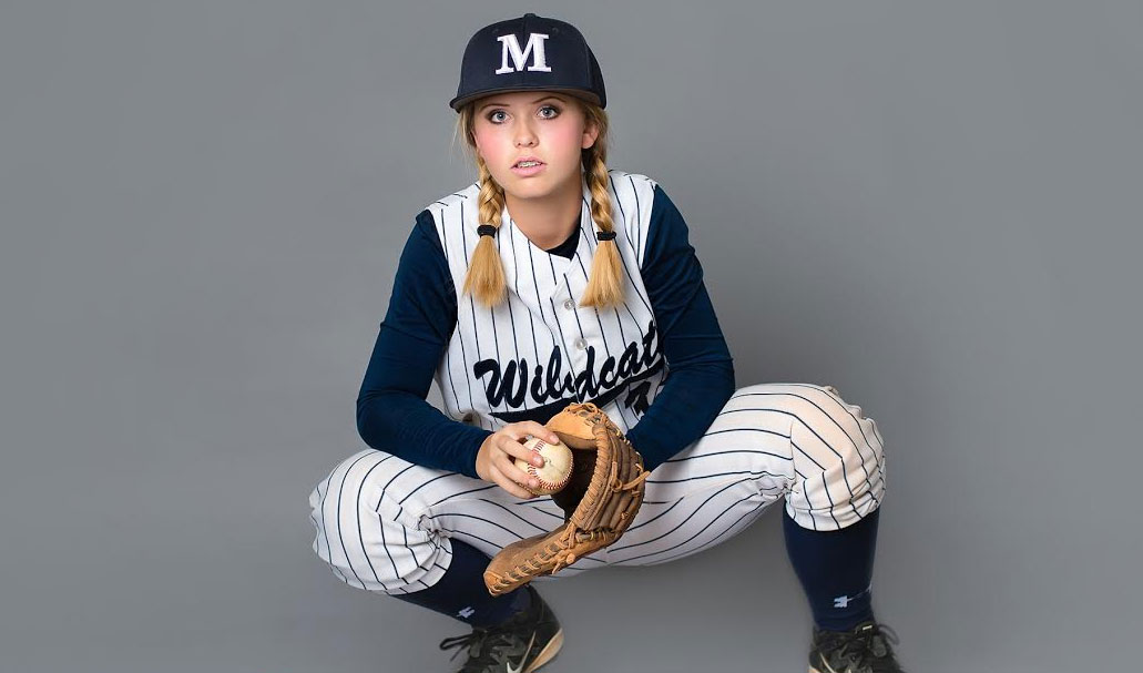 Sydney Dore, 14, in her baseball uniform (Courtesy of McKeel Academy of Technology)