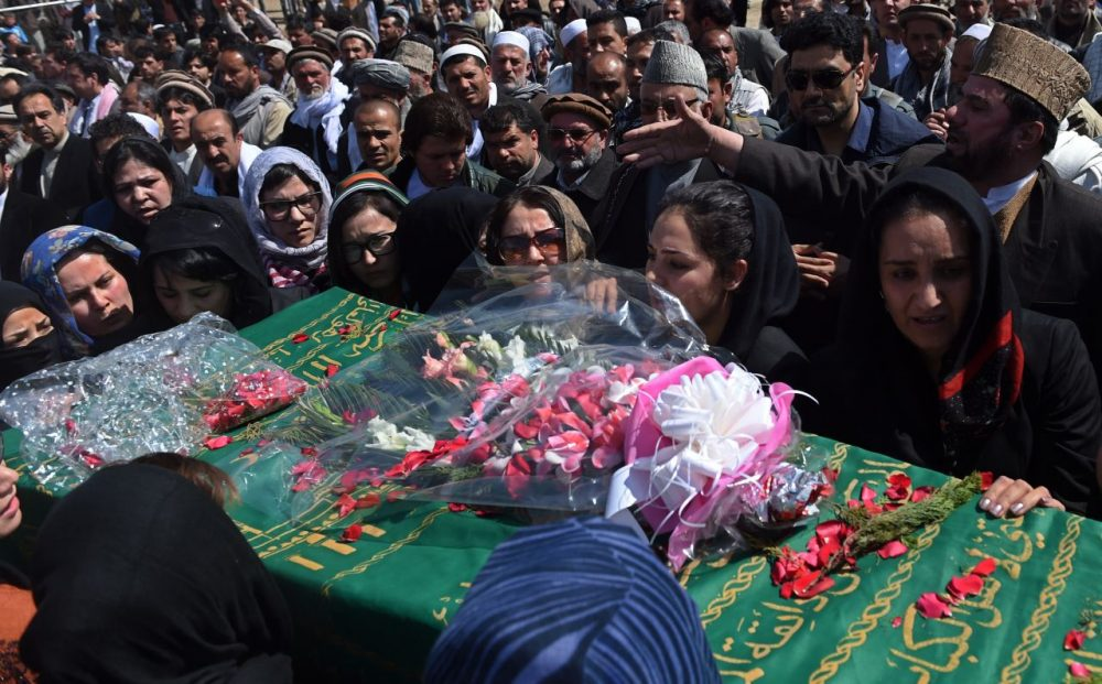 Hundreds of people  attended the burial of an Afghan woman on Sunday. She was beaten to death and set on fire by a mob for allegedly burning a copy of the Qur'an.  (Wakil Kohsar/AFP/Getty Images)