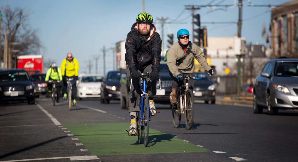 Cyclists ride down Commonwealth Avenue on Wednesday morning. Under a city plan, this section of the busy road would have protected bike lanes. (Robin Lubbock/WBUR)