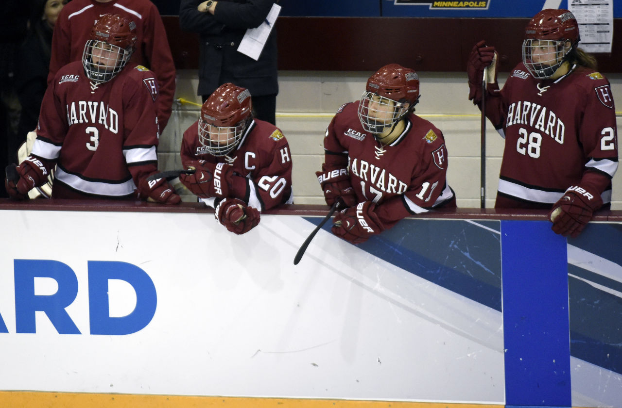 Harvard's Sarah Edney (3), Michelle Picard (20), Briana Mastel (17) and Abbey Frazer (28) watch from the bench in the final minute. (Hannah Foslien/AP)