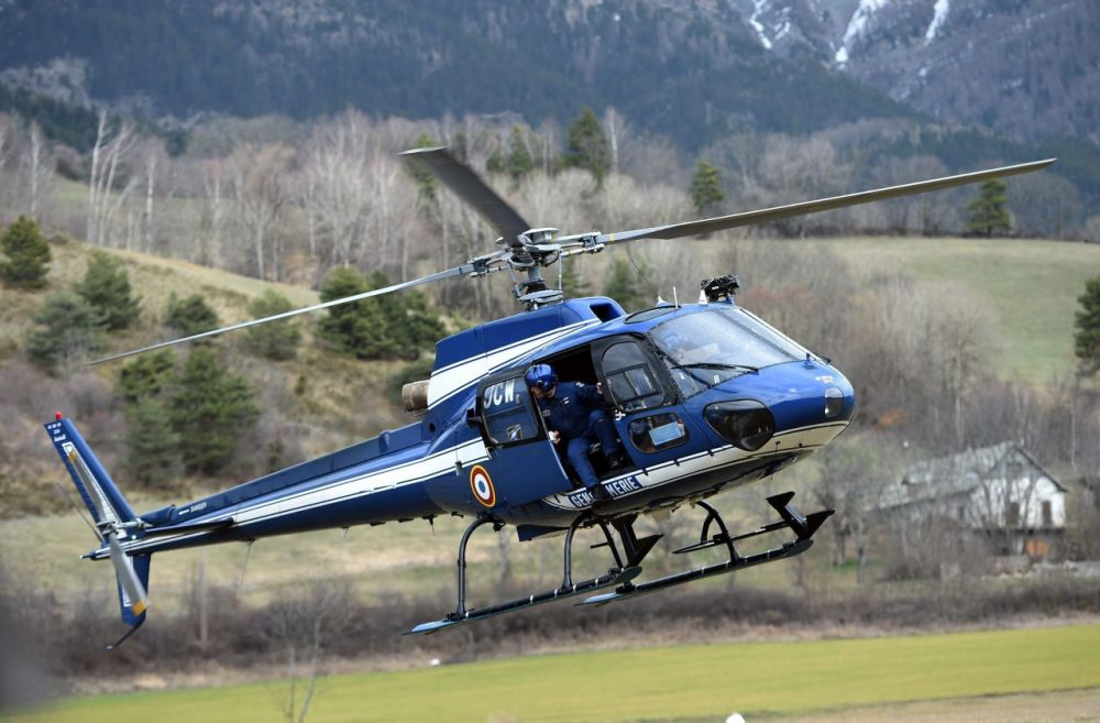 An Aerospatiale AS350 Ecureuil helicopter of the French National Gendarmerie is seen in Seyne, south-eastern France, on March 24, 2015, near the site where a Germanwings Airbus A320 crashed in the French Alps. (Anne-Christein Poujoulat /AFP/Getty Images)