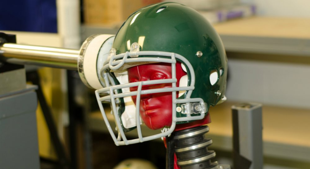 Bill Littlefield says despite mounting research, statistics and growing scientific concern about the link between football and brain disease, it appears the attitude of the NFL is the same as it ever was. This photo, provided by the Southern Impact Research Center in Tennessee, taken June 18, 2014, shows equipment that can test how football helmets perform against certain concussion-causing forces. There is no concussion-proof football helmet, but an organization that sets safety standards for athletic equipment was preparing new testing criteria. (AP)