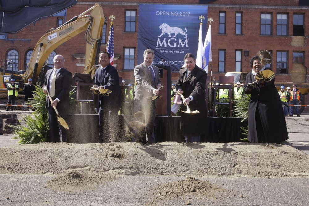 From left: Massachusetts Gaming Commission Chair Stephen Crosby; Michael Mathis, president and COO of the MGM Springfield Casino Resort; James Murren, chairman and CEO of MGM Resorts International; Springfield Mayor Domenic Sarno; and Ethel Griffin, a member of HAP Housing's board of directors, on Tuesday take part in a photo-op during a ground breaking ceremony for the $800 million MGM casino resort scheduled to open in 2017 in Springfield. (Stephan Savoia/AP)