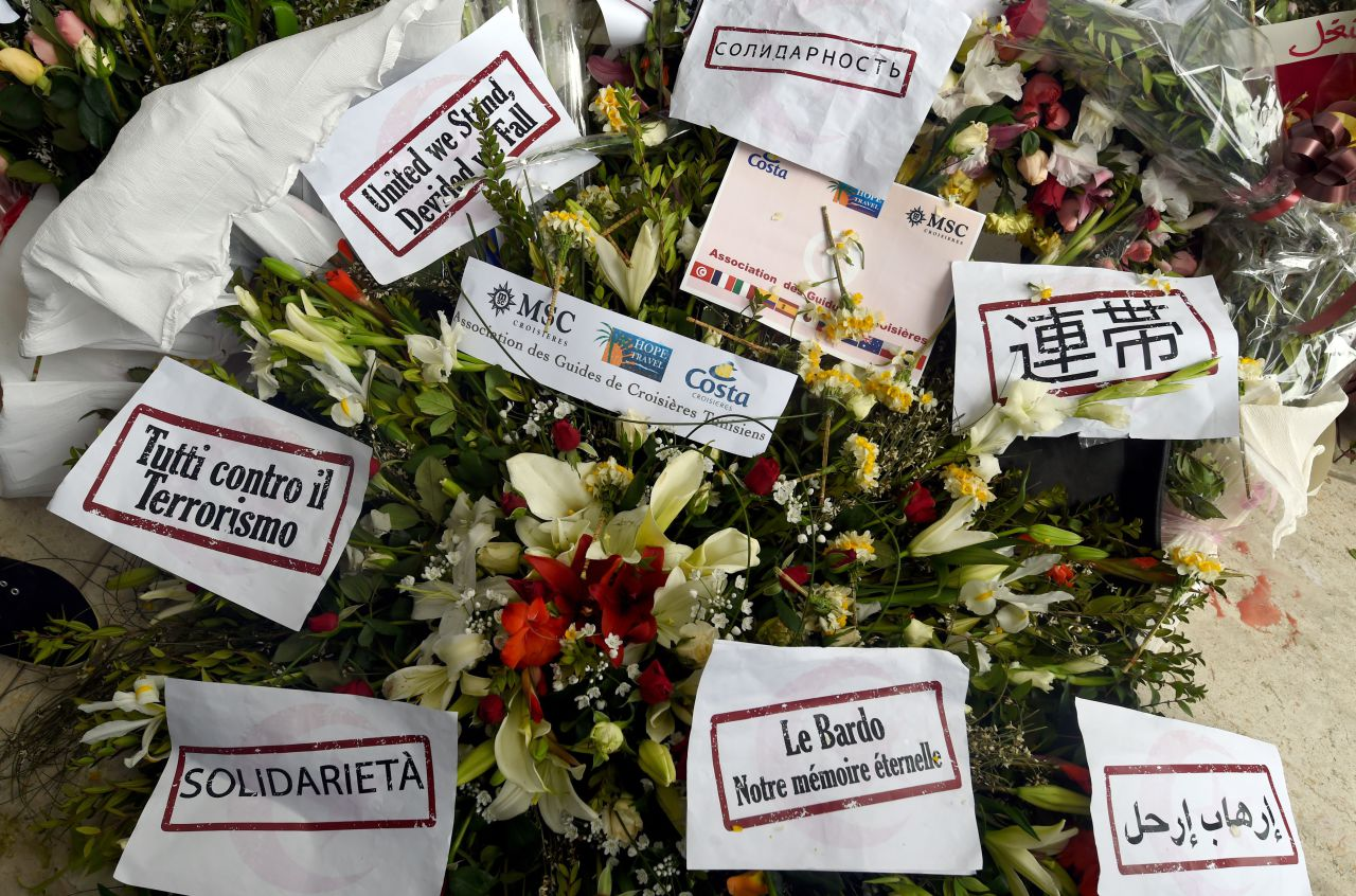 Flowers and messages of condolences are laid outside Tunisia's Bardo National Museum on March 24, 2015 in Tunis. (Fethi Belaid/AFP/Getty Images)