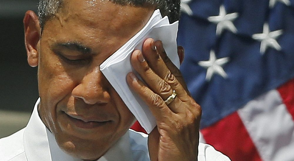 President Obama has the chance to implement a legally binding deal on greenhouse gas reductions, without being hamstrung by a recalcitrant Congress. In this photo, Obama wipes sweat from his brow during a speech on climate change at Georgetown University in July 2013. (Evan Vucci/AP)