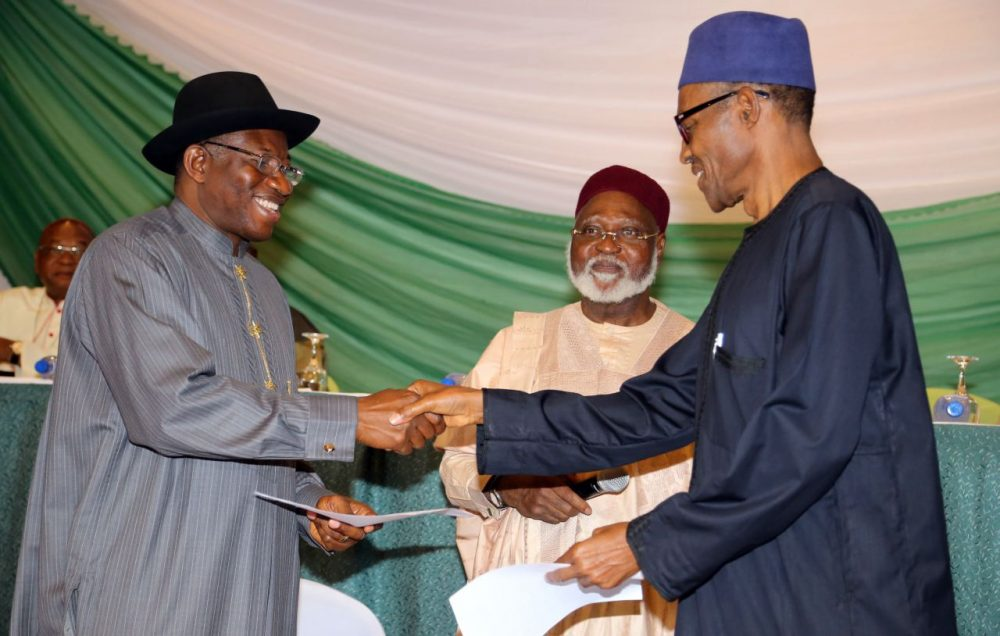 Nigerian President Goodluck Jonathan (left), and APC main opposition party's presidential candidate Mohammadu Buhari shake hands under the eyes of Chairman of the Abuja Peace Accord former Head of State General Abdulsalami Abubakar (center), after signing the renewal of the pledges for peaceful elections on March 26, 2015 in Abuja. Security is a major concern at Saturday's vote both from Boko Haram violence against voters and polling stations to clashes between rival supporters. In 2011, around 1,000 people were killed in violence after Jonathan beat Buhari to the presidency. (Philip Ojisua/AFP/Getty Images)