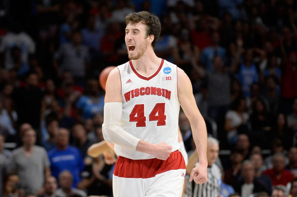 Wisconsin's senior center Frank Kaminsky had a lot to celebrate after his team defeated UNC to advance to the Elite Eight. But more fans watched the badger's football team in the Outback Bowl. (Harry How/Getty Images)