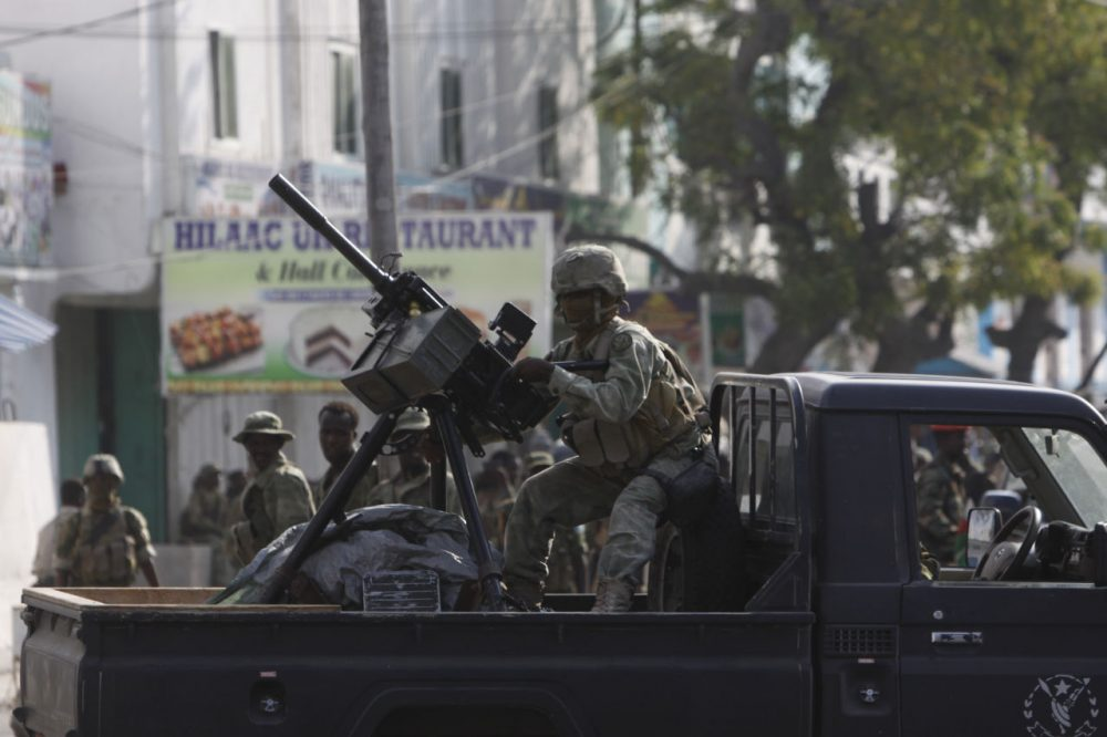 A Somali soldier takes position during fighting with militants who were inside the Maka Almukaramaha Hotel in Mogadishu, Somalia. (Farah Abdi Warsameh/AP)