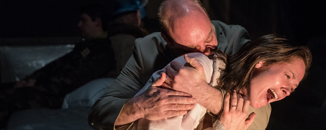 """Mel (Tamara Hickey) crying into Ted's (Gabriel Kuttner's) arms in """"God's Ear."""" (Stratton McCrady Photography)"""
