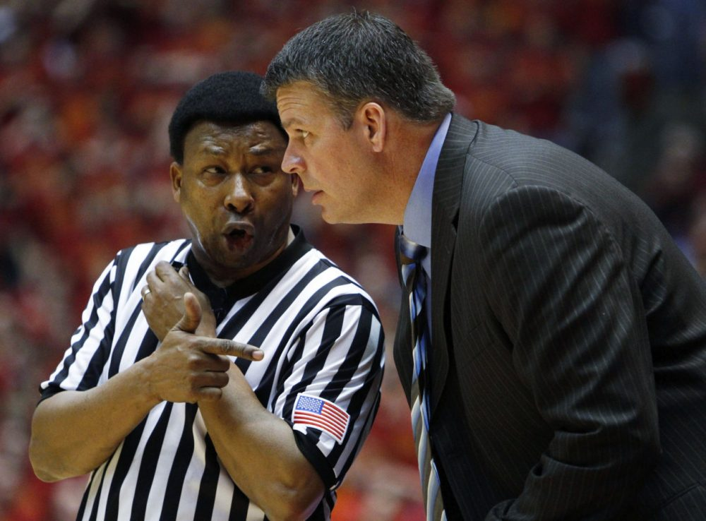 Iowa State coach Greg McDermott talks with referee Ed Hightower during the first half of an NCAA college basketball game against Texas, Wednesday, Jan. 13, 2010, in Ames, Iowa. Texas won 90-83. (AP)