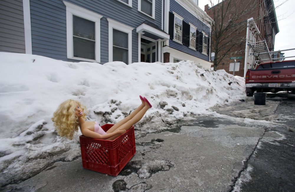 A doll in a milk crate saves a parking space on a residential street in South Boston last month. (Elise Amendola/AP)