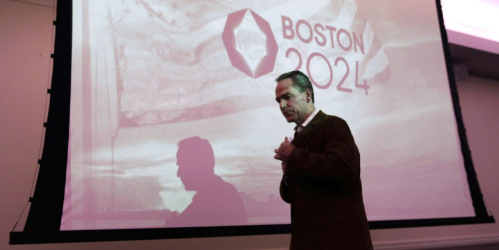 John Fish, chair of Boston 2024, heads back to his seat after addressing a public forum last month about Boston's 2024 Olympics bid. (Charles Krupa/AP)