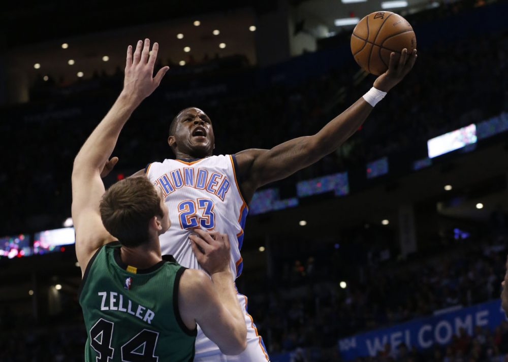 Oklahoma City Thunder guard Dion Waiters (23) shoots as Boston Celtics center Tyler Zeller (44) defends in the first quarter. (AP/Sue Ogrocki)
