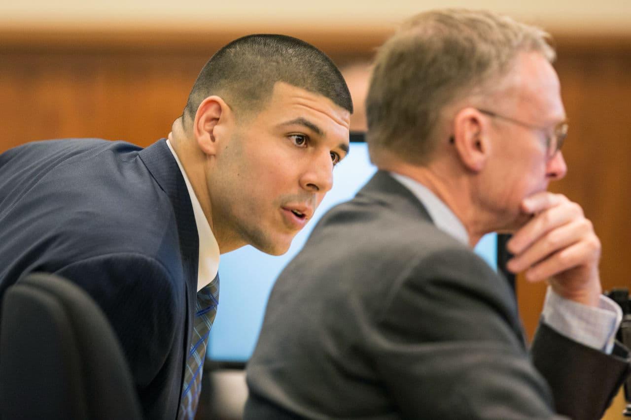 Aaron Hernandez, left, speaks with his attorney during testimony Monday. (Aram Boghosian/The Boston Globe/Pool)
