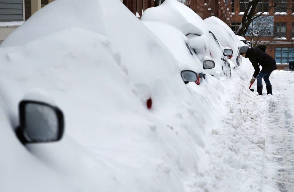 Jill Leach shovels her car near her home in Charlestown last month. (Elise Amendola/AP)