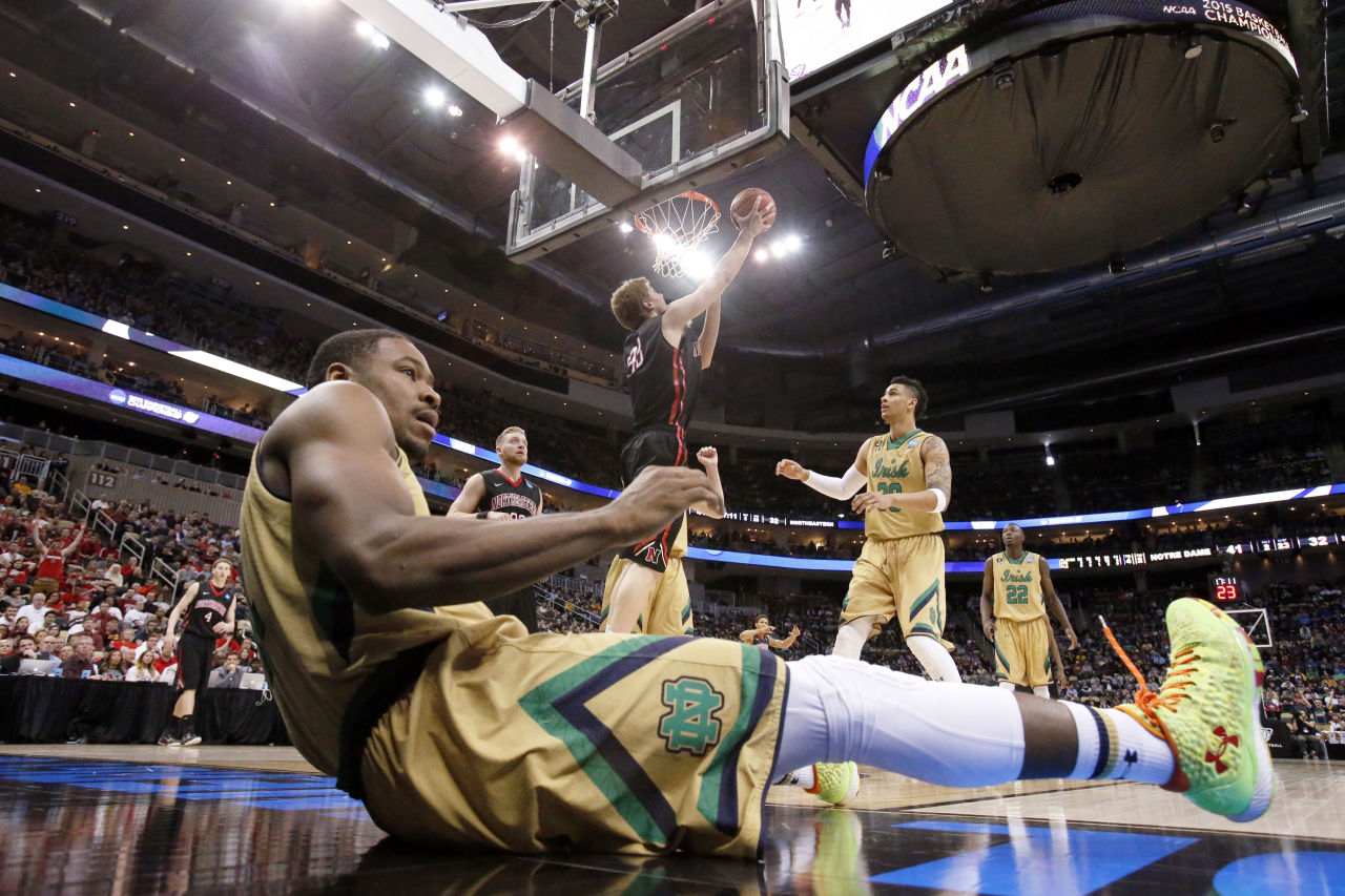 Notre Dame's Demetrius Jackson rolls on the floor after trying to stop Northeastern's Scott Eatherton. (Gene J. Puskar/AP)