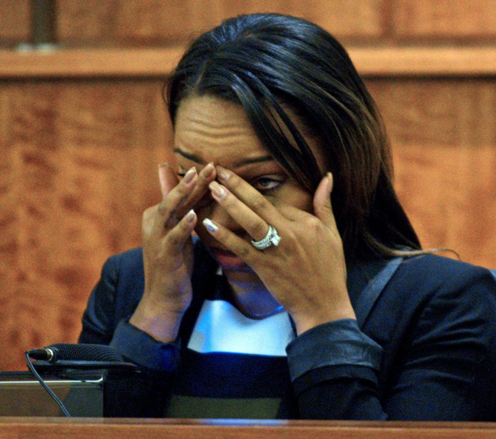 Shayanna Jenkins, the fiancee of former NFL football player Aaron Hernandez, cried as she testified in court during his murder trial Monday. (Ted Fitzgerald/Boston Herald/Pool)