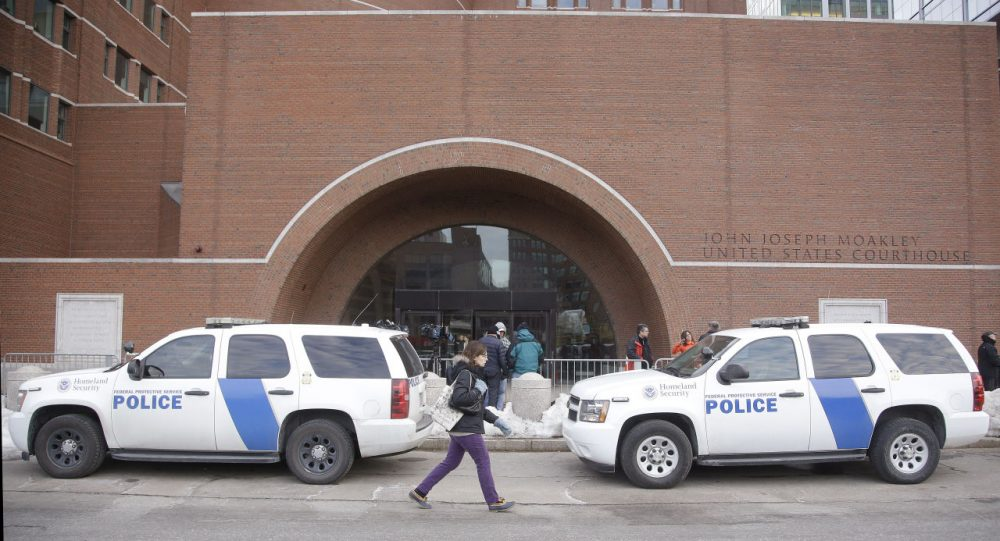 Homeland Security vehicles were staged outside the main doors of the federal courthouse in Boston on Monday. (Stephan Savoia/AP)