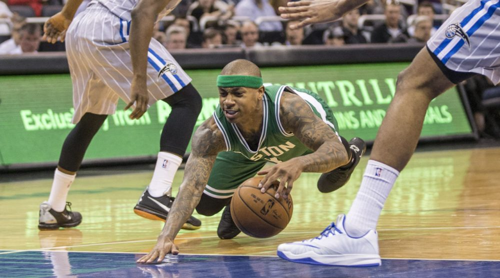 Celtics guard Isaiah Thomas (4) looses his balance and goes down during the second half of an NBA basketball game in Orlando, Fla., Sunday, March 8, 2015. (AP Photo/Willie J. Allen Jr.)