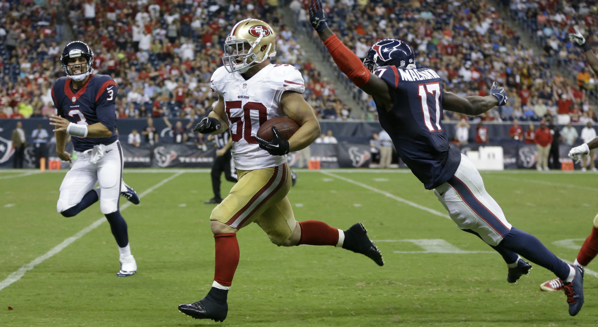 NFL rookie Chris Borland quits after one season, and an actor declines an offer to be the voice of the sport.  Pictured: Borland, playing for the San Francisco 49ers, runs an interception back for a touchdown past Houston Texans' Uzoma Nwachukwu during the third quarter of an NFL football preseason game Thursday, Aug. 28, 2014, in Houston. (Patric Schneider/AP)