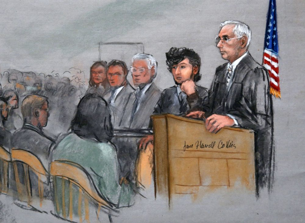 In this courtroom sketch, Boston Marathon bombing suspect Dzhokhar Tsarnaev, second from right, is depicted with his lawyers, left, beside U.S. District Judge George O'Toole Jr., right, as O'Toole addressed a pool of potential jurors in early January. (Jane Flavell Collins/AP)