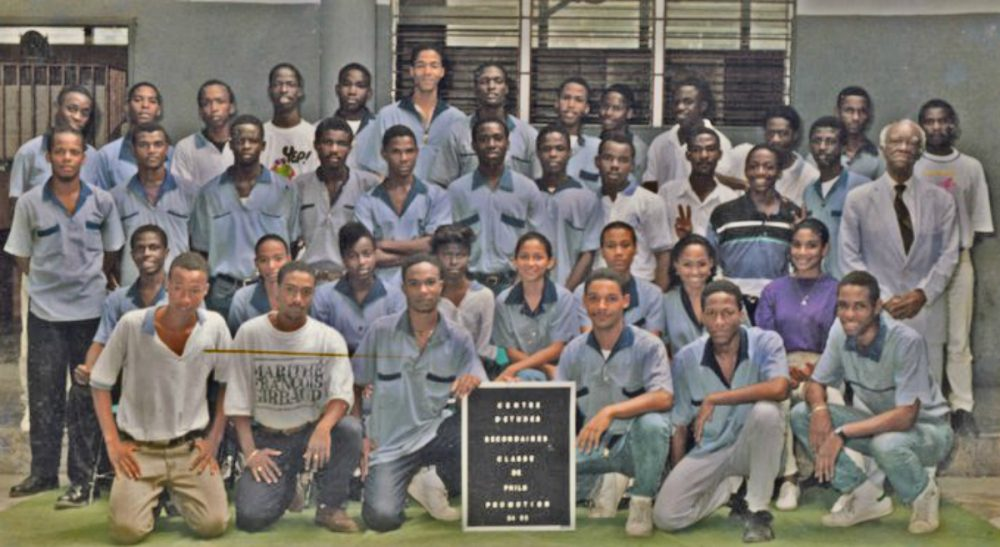 """Jeff Lahens: """"""""Twenty years ago, my brothers and I cracked the code of the power of clothing. In a country where opportunities were limited, we aimed high."""" Pictured: The graduating class of 1995 at the Centre d'Etudes Secondaires in Port-au-Prince, Haiti. The author stands seventh from the left in the back row . (Jeff Lahens/Courtesy)"""