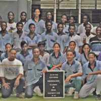 "Jeff Lahens: """"Twenty years ago, my brothers and I cracked the code of the power of clothing. In a country where opportunities were limited, we aimed high."" Pictured: The graduating class of 1995 at the Centre d'Etudes Secondaires in Port-au-Prince, Haiti. The author stands seventh from the left in the back row . (Jeff Lahens/Courtesy)"