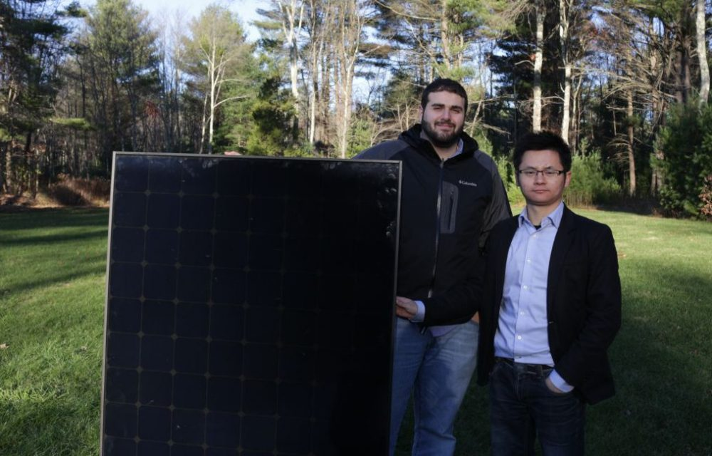 Two of the founders of CloudSolar, Cory Absi, left, and Michael Sun, right, stand by a solar panel. (Courtesy CloudSolar)