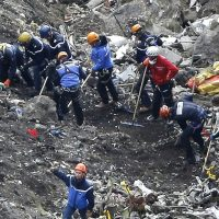 "Tom LeCompte: ""Who's going to land the plane if things go wrong? We already ride on trains without engineers and are preparing for driverless cars. Why not pilotless airliners?"" Pictured: Rescue workers work on debris of the Germanwings jet at the crash site near Seyne-les-Alpes, France, Thursday, March 26, 2015. The co-pilot of the Germanwings jet barricaded himself in the cockpit and ""intentionally"" rammed the plane full speed into the French Alps, ignoring the captain's frantic pounding on the cockpit door and the screams of terror from passengers, a prosecutor said Thursday. In a split second, he killed all 150 people aboard the plane. (Laurent Cipriani/AP)"