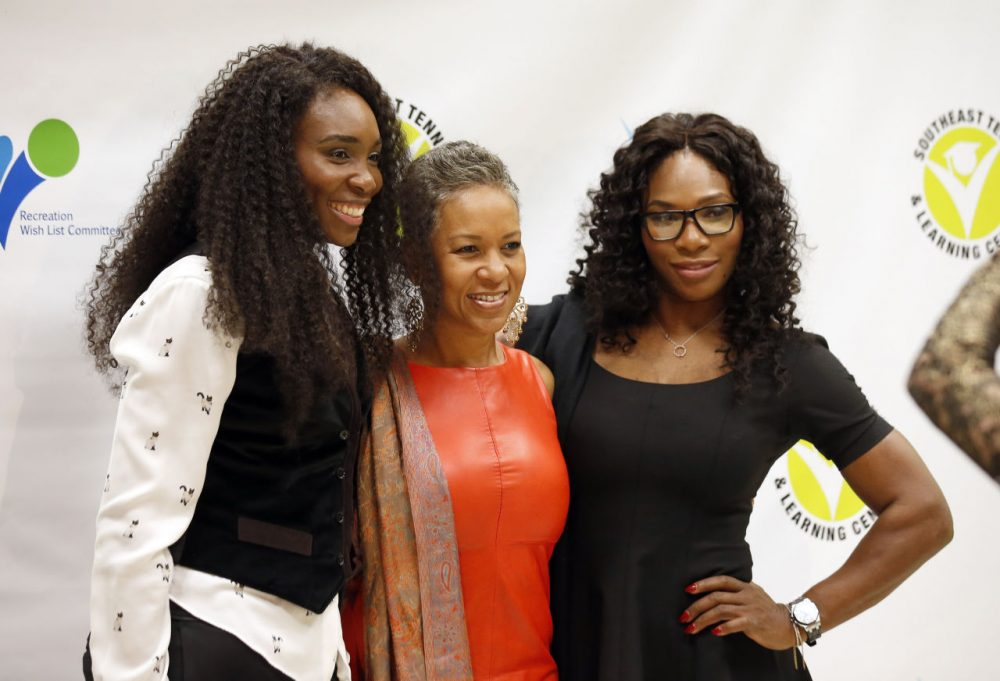 Tennis champions Venus Williams, left, and Serena Williams, right, pose for photographers with Katrina Adams at an event on Friday, Nov. 7, 2014, in Washington. (Alex Brandon/AP)