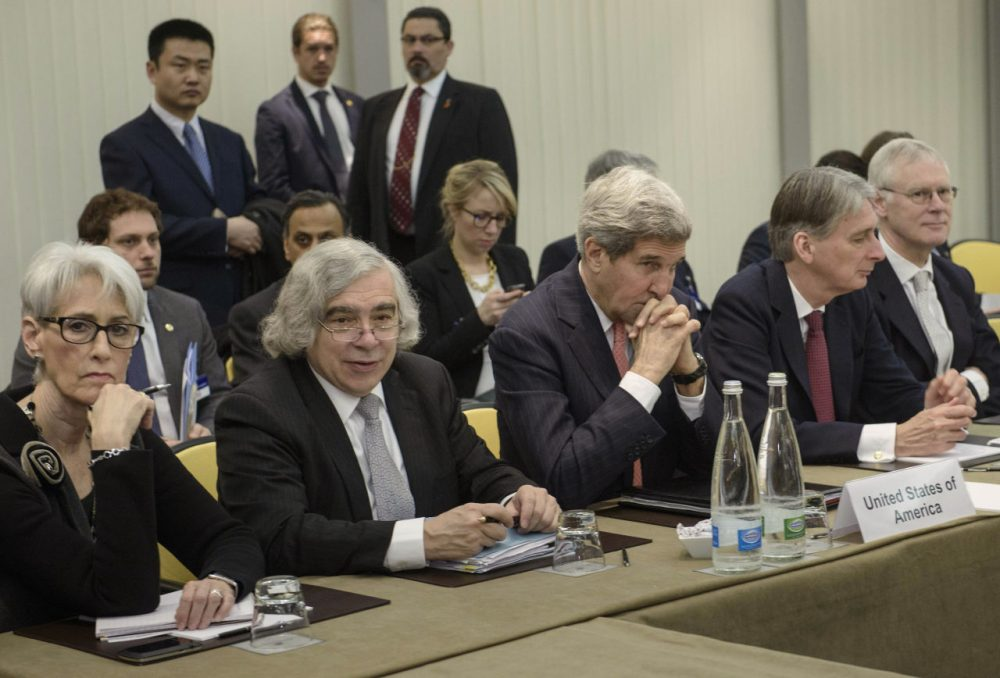 U.S. Secretary of State John Kerry, center, and British Foreign Secretary Philip Hammond, second right, waits with U.S. Under Secretary for Political Affairs Wendy Sherman, left, U.S. Secretary of Energy Ernest Moniz, second left, and others before a meeting Lausanne, Switzerland Monday, March 30, 2015, during Iran nuclear talks. (Brendan Smialowski/AP)