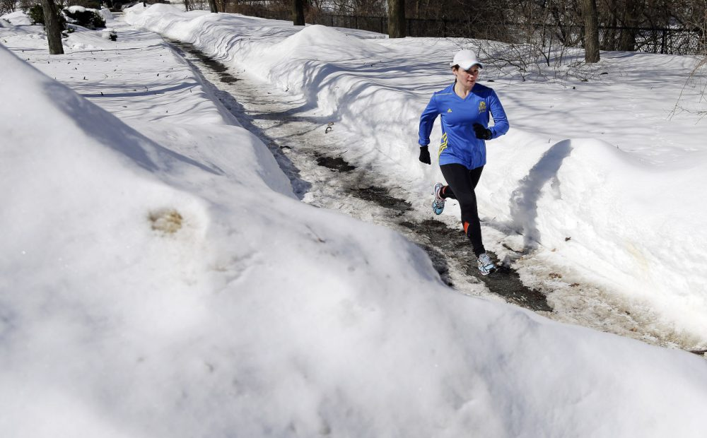 Runner Becca Pizzi, 34, trains along Heartbreak Hill in Newton, Mass., Friday, Feb. 27. (Elise Amendola/AP)