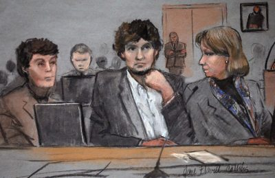 In this courtroom sketch, Dzhokhar Tsarnaev, center, is depicted between defense attorneys Miriam Conrad, left, and Judy Clarke, right, during his federal death penalty trial. (Jane Flavell Collins/AP)