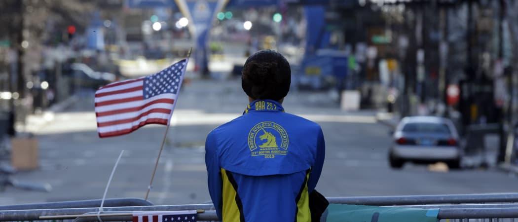 A woman pauses near the barricades blocking off Boylston Street in the days after the 2013 Boston Marathon bombings. (Matt Rourke/AP)
