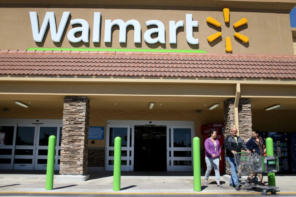 Walmart customers exit from the store on February 19, 2015 in Miami, Florida. (Joe Raedle/Getty Images)