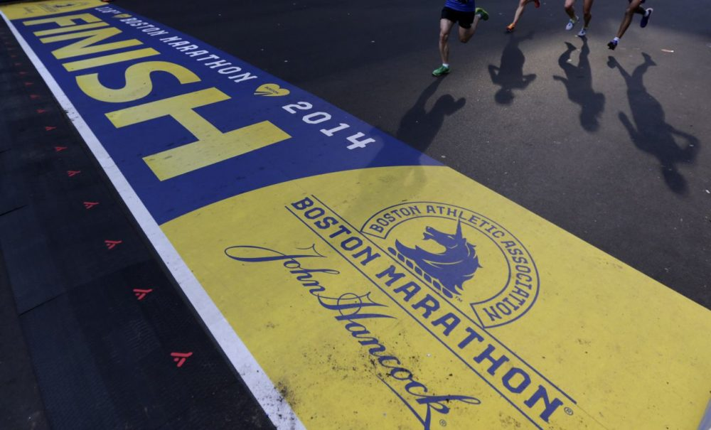 Runners approach the finish line of the Boston Marathon during a 5K race in 2014. (Charles Krupa/AP)