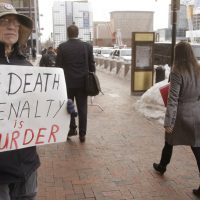 Harvey Silverglate: It's tempting to believe that Dzhokhar Tsarnaev deserves to have entire weight of the country's prosecutorial might bearing down on him. But does it help our community heal? In this photo, Joe Kebartas of South Boston holds anti-death penalty sign as he stands next to the federal courthouse Monday March 9, 2015, in Boston, during the federal death penalty trial of Tsarnaev. (Stephan Savoia/AP)