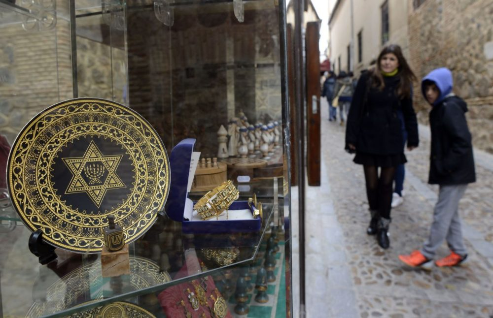 People stand near a gift shop in the old Jewish Quarters of Toledo on February 27, 2014. (Gerard Julien/AFP/Getty Images)