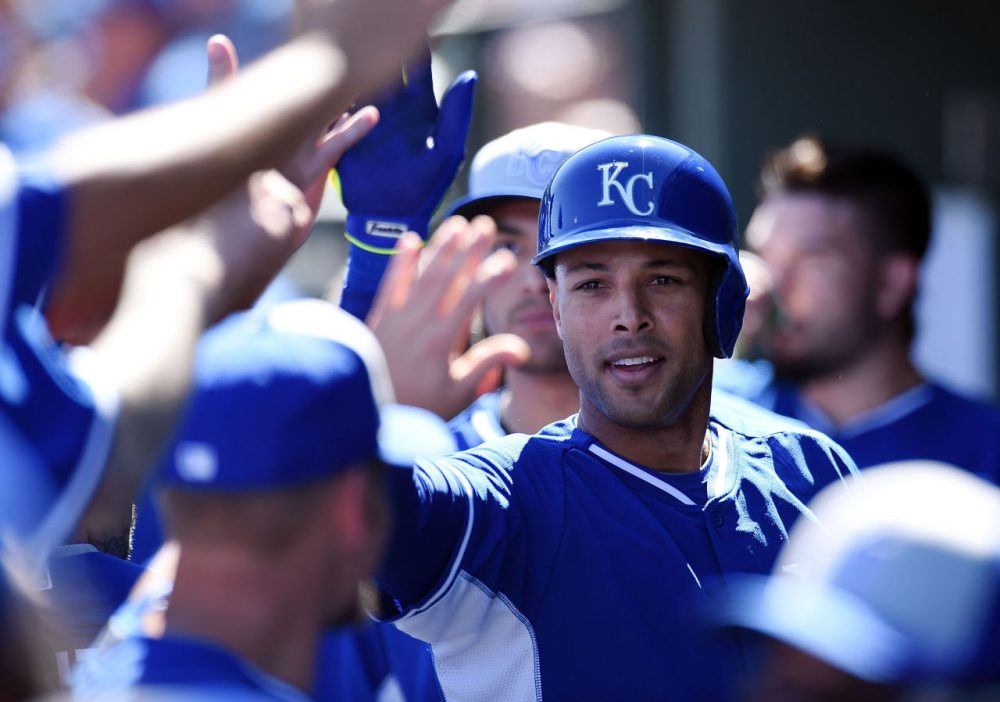 Alex Rios #15 of the Kansas City Royals celebrates with teammates after hitting a first inning home run against the Texas Rangers on March 4, 2015 in Surprise, Arizona. (Norm Hall/Getty Images)